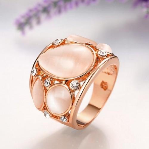 Rosegoldfarbener Ring mit Cateye Steinen und Strass als Modeschmuck Fingerring