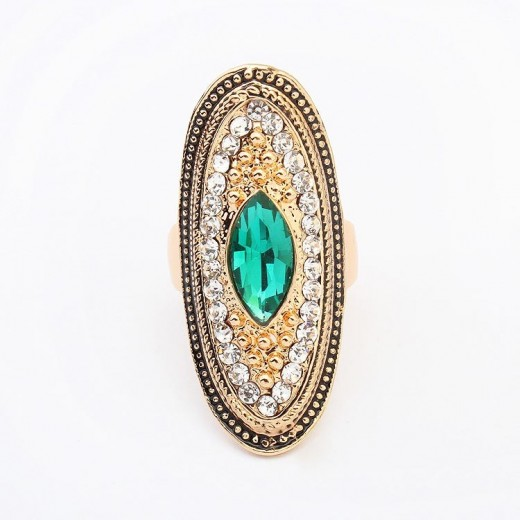 Opulenter gold Ring mit kleinen transparenten und einem ovalem petrolfarbenem Stein Modeschmuck Fingerring
